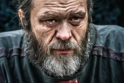 Homeless poor man crying portrait closeup. Economic recession, unemployment, poverty, hunger, retirement, global crisis, inequality problem concept.