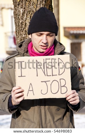 homeless with cardboard looking for a job