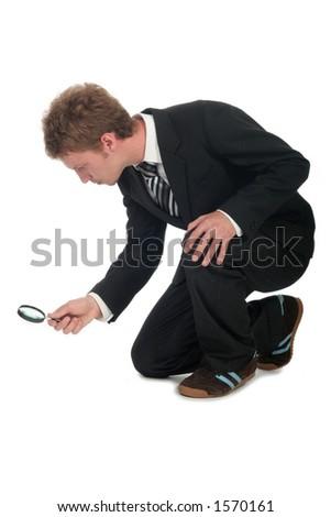 Homem de negócios Que Prende O Vidro Ampliando - stock photo