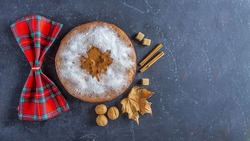 Homemade apple pie, cobbler, charlotte with walnut and cinnamon. Thanksgiving dish serving with checkered napkin. Autumn harvest festival. Copy space for text