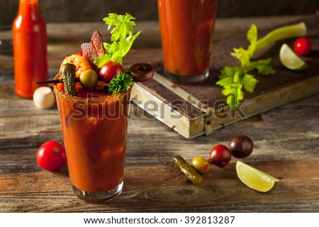 Photo of  Homemade Bacon Spicy Vodka Bloody Mary with Tomatos, Olive and Celery