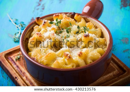 Homemade baked macaroni and cheese with grated parmesan cheese on top