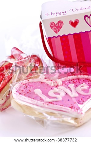 Homemade baked shortbread Valentine cookies with icing and gift boxes