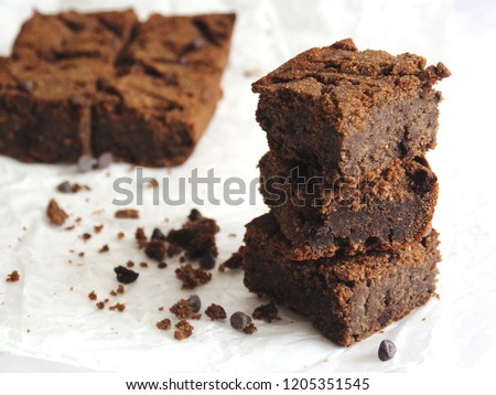 Homemade baked stack brownie pieces, close up