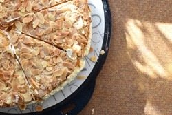 Homemade bee sting cake with flaked almonds and a cream for the birthday party with coffee and cake in Germany - bee sting baked as round cake