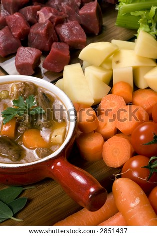 Homemade beef stew with fresh vegetables herbs and spices.