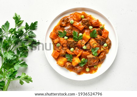 Homemade beef stew with potatoes and carrots in tomato sauce. Top view, flat lay Foto stock ©