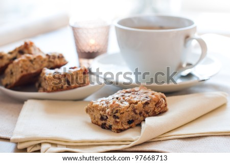 Homemade biscuits and a cup of tea on the table in the morning