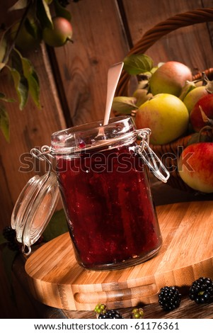 Homemade blackberry and apple jam with autumn fruits