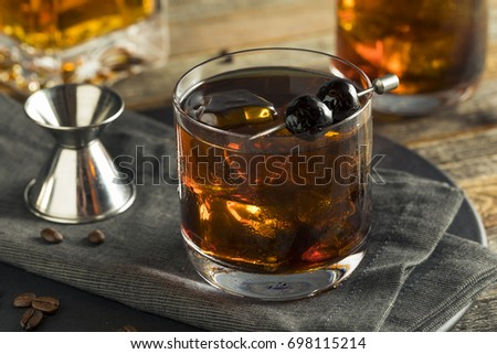 Homemade Boozy Coffee Old Fashioned with Bourbon and Cherries #698115214