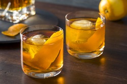 Homemade Boozy Old Fashioned Cocktail with Whiskey and a Sphere Ice Cube