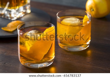 Homemade Boozy Old Fashioned Cocktail with Whiskey and a Sphere Ice Cube #656783137