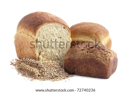 Homemade bread and stalks of wheat on a white background