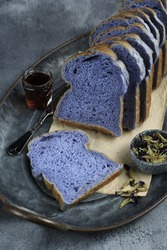 Homemade bread with butterfly pea flower in the ingredients, giving a light purple color to the dough. Selective focus