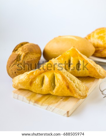 Homemade breads on white background