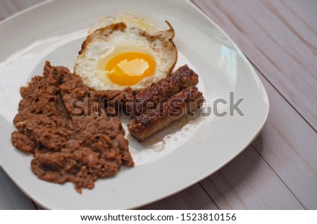 Homemade breakfast egg sausage and fried beans