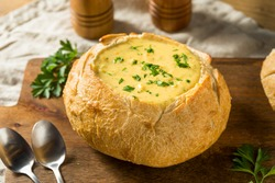 Homemade Broccoli Cheddar Soup in a Bread Bowl Ready to Eat