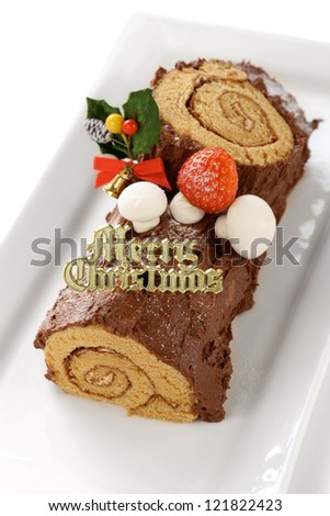 homemade buche de noel, chocolate yule log christmas cake - stock photo