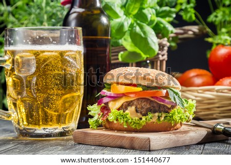 Homemade burger and a cold beer