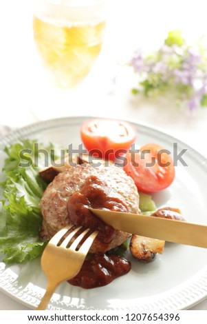 Homemade burger served with mushroom served with iced tea #1207654396