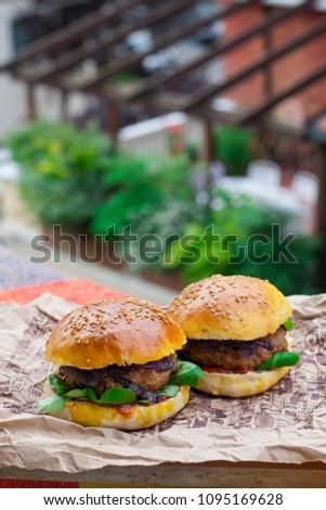 Homemade burger (with homemade bread). Foto was made on balcony in Italy. #1095169628