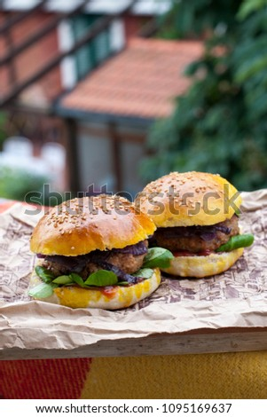 Homemade burger (with homemade bread). Foto was made on balcony in Italy. #1095169637