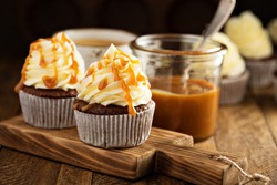 Homemade butterscotch cupcakes with caramel syrup and cream cheese frosting
