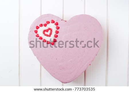 Homemade cake In the form of heart on the white wooden background. Top view. #773703535