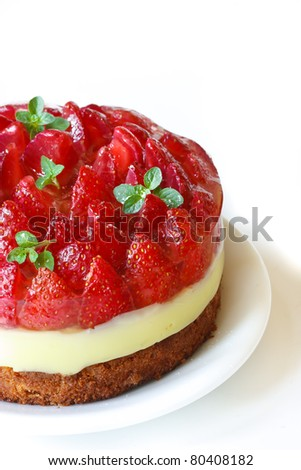 Homemade cake with cream and jelly strawberries.