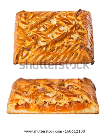 Homemade cake with dried apricots and almonds white background.