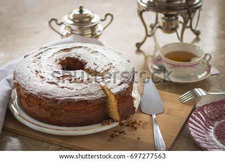 Homemade cake with tea in a delightful meal #697277563