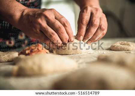 homemade cakes of the dough in the women\'s hands. The process of making pie dough by hand