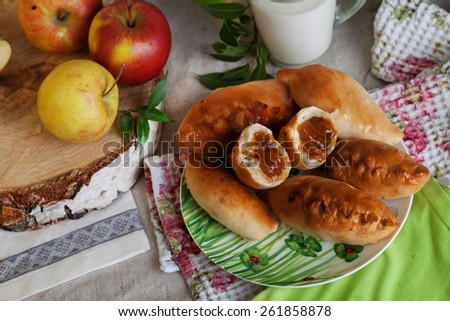 homemade cakes with apple jam in a still life, a mug of milk