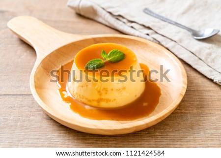 homemade caramel custard pudding with mint Stock photo ©