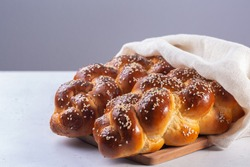 Homemade Challah with white cover -  special bread in Jewish cuisine.Main ingredients are eggs, white flour, water, sugar, salt  and yeast. Decorated  with sesame and poppy seeds.