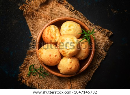 Homemade cheese buns, rustic style, vintage wooden background, top view