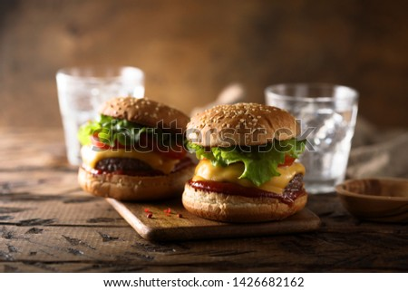 Homemade cheeseburgers with lettuce and tomato ketchup Stock photo ©