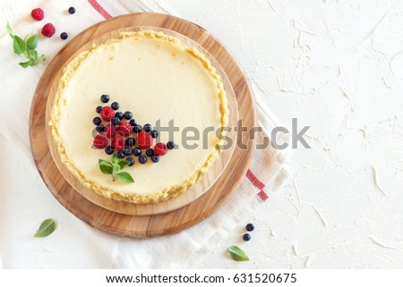 Homemade cheesecake with fresh berries and mint for dessert - healthy organic summer dessert pie cheesecake. Cheese cake.