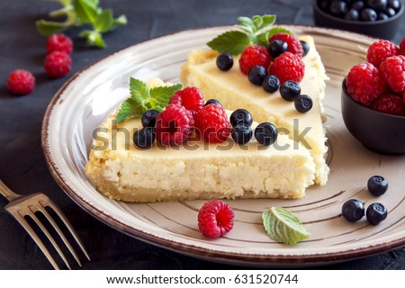 Homemade cheesecake with fresh berries and mint for dessert - healthy organic summer dessert pie cheesecake. Cheese cake. #631520744