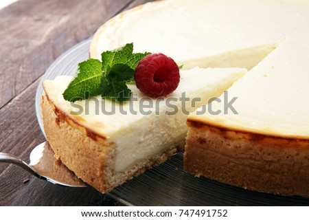 Homemade cheesecake with fresh berries and mint for dessert - healthy organic summer dessert pie cheesecake. Cheese cake