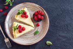 Homemade cheesecake with fresh raspberries and mint for dessert - healthy organic summer dessert pie cheesecake. Vanilla Cheese Cake.
