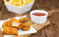 Homemade Chicken Nuggets on vintage background (selective focus; close-up shot)
