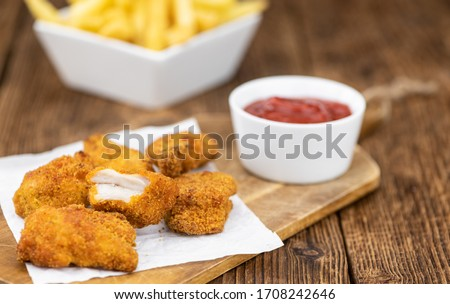 Homemade Chicken Nuggets on vintage background (selective focus; close-up shot) Сток-фото ©