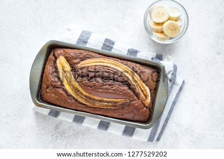 Homemade Chocolate Banana Bread on white background, copy space. Healthy banana bread or cake with dark chocolate for breakfast, top view. #1277529202