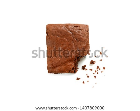 Homemade chocolate brownie with crumbs isolated on white background. Top view.