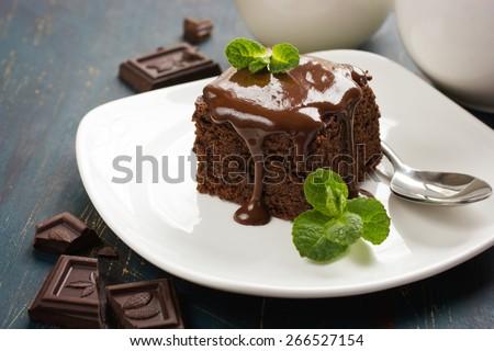 homemade chocolate brownies on dark background