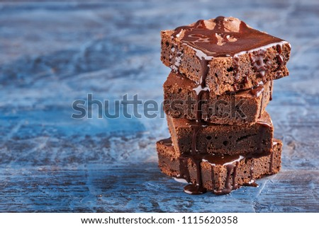 homemade chocolate brownies on dark blue background #1115620358
