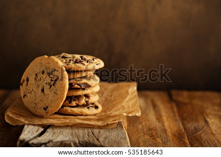 Homemade chocolate chip cookies stacked in a rusting setting #535185643