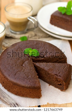 Homemade chocolate fondant cake with mellow filling with a leaf of mint for coffee Photo stock ©