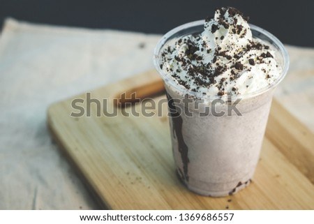 Homemade chocolate milkshake with cookie crumbs on top. on the wooden table. Fresh sweet drink on the wooden table. - Image Stock photo ©
